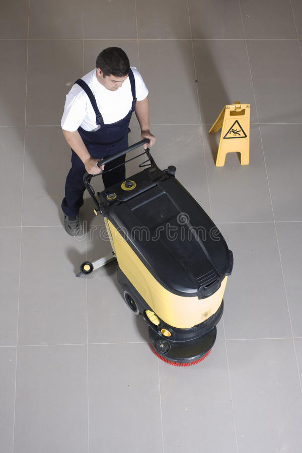 Cleaning floor with big machine stock photos