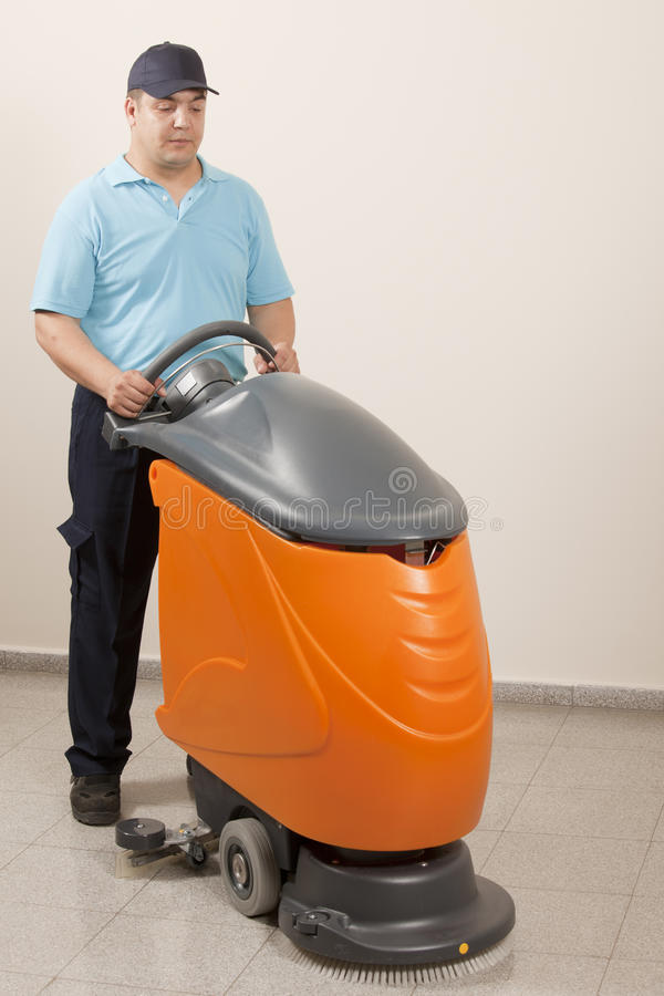 Cleaning floor with big machine royalty free stock images