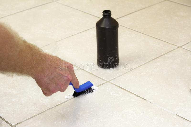 Cleaning Floor Grout with Baking Soda royalty free stock photography