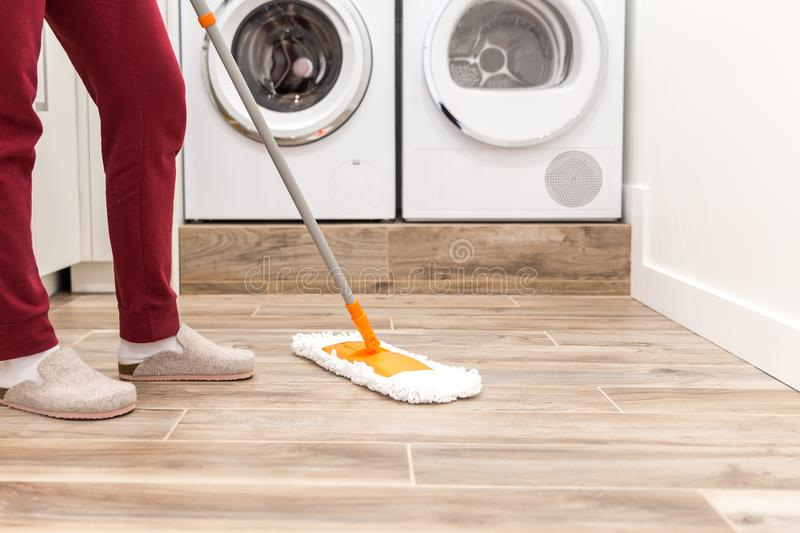 Cleaning floor in laundry room in modern house royalty free stock photos
