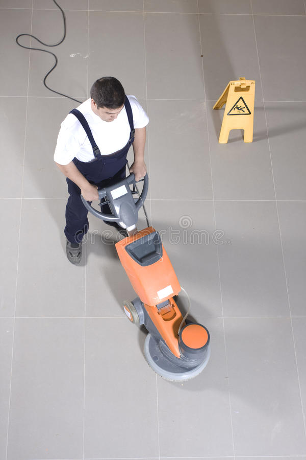 Cleaning floor with machine royalty free stock photos
