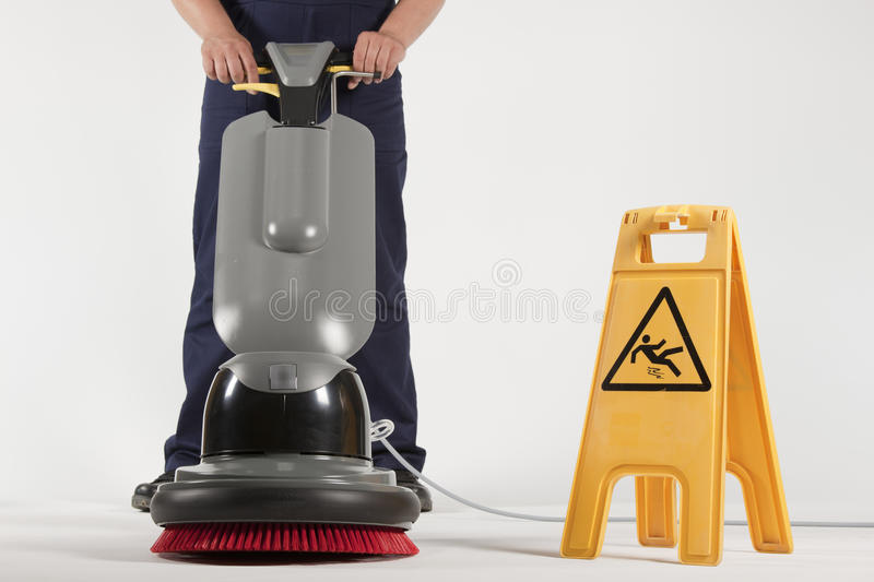 Cleaning floor with machine stock image