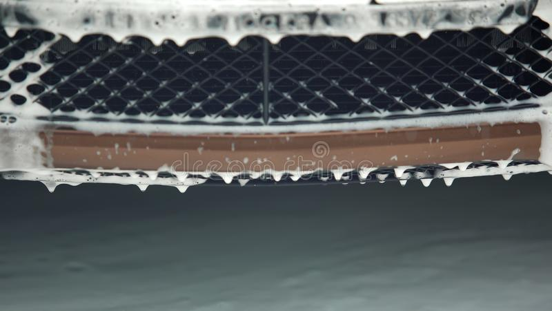 Cleaning foam flowing down the radiator, carwash service, profitable business. Stock footage royalty free stock images