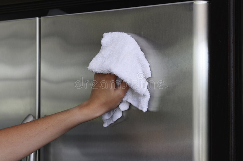 Cleaning the fridge stock image