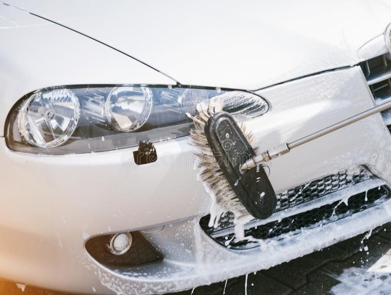 Vehicle gets brushed and covered with foam. royalty free stock photo