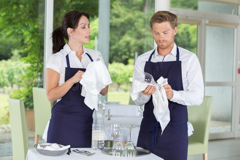 Cleaning glasses at restaurant. Cleaning glasses at a restaurant royalty free stock images