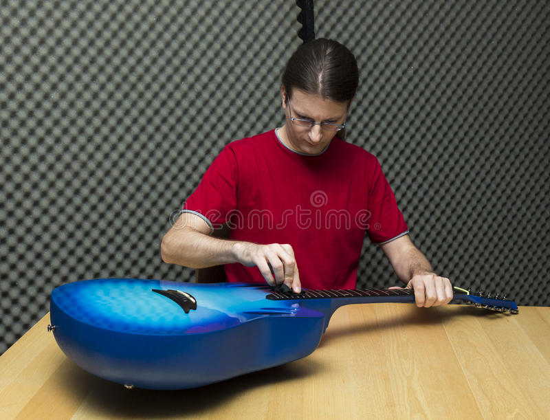 Cleaning the guitar stock photos