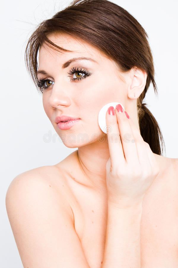 Cleaning her face royalty free stock photography