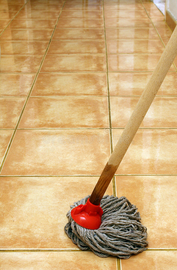 Cleaning at home with mop. Cleaning the floor with mop royalty free stock photography