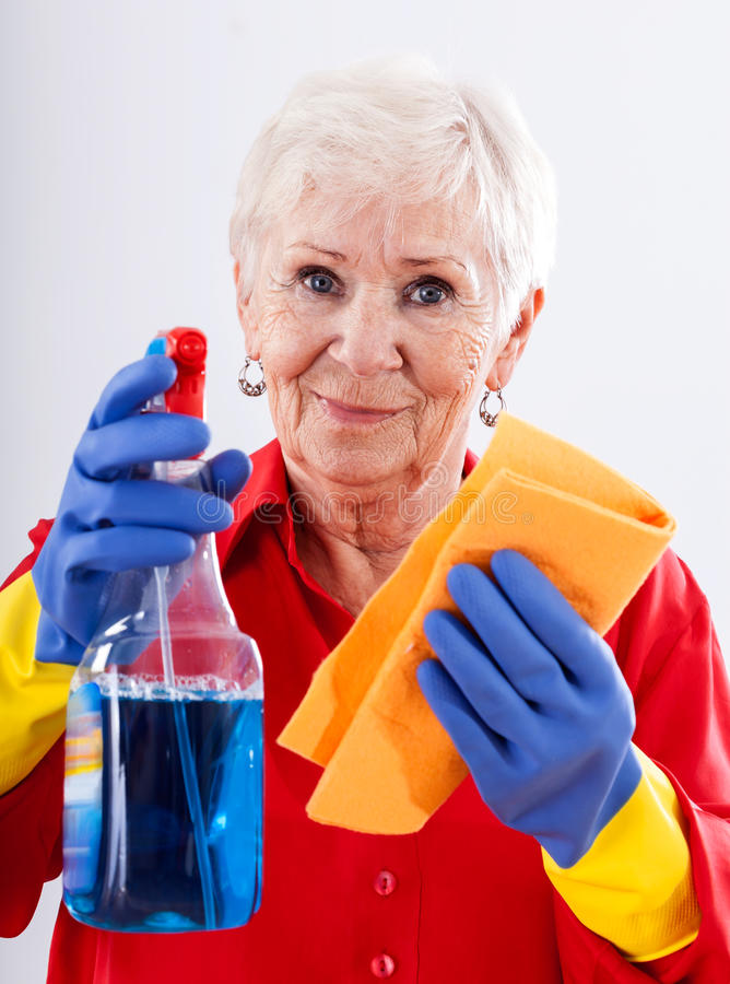 Cleaning house. Old person on white isolated background cleaning house royalty free stock photos