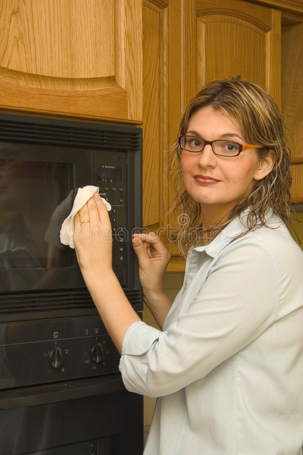 Cleaning the house - microwave oven stock images