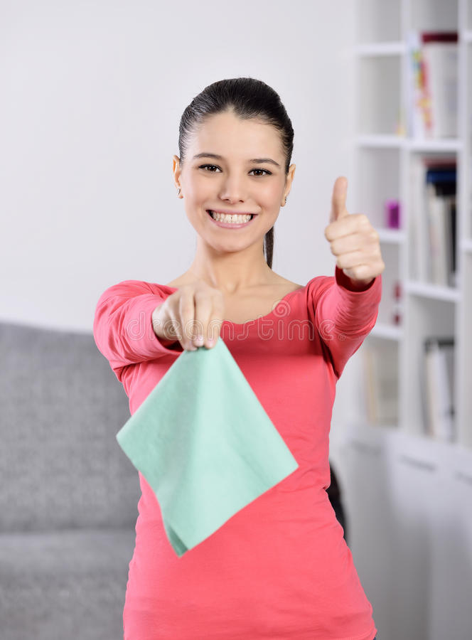Cleaning the house. Women cleaning house finish. attractive girl looking at camera ok sign stock photos