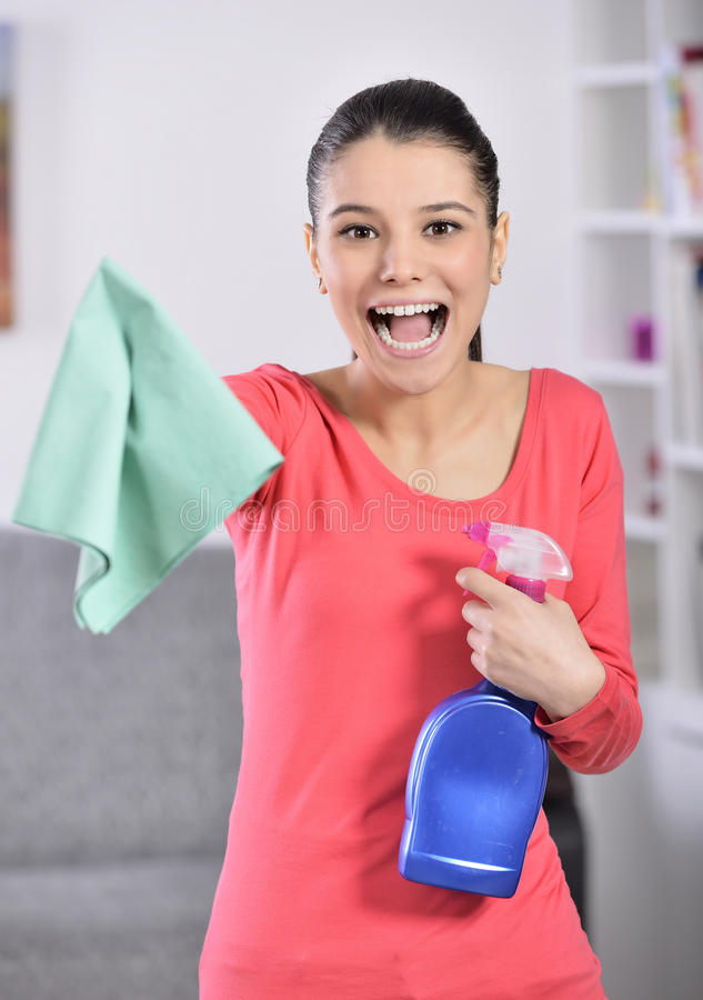Cleaning the house. Women cleaning house finish. attractive girl looking at camera ok sign royalty free stock photography