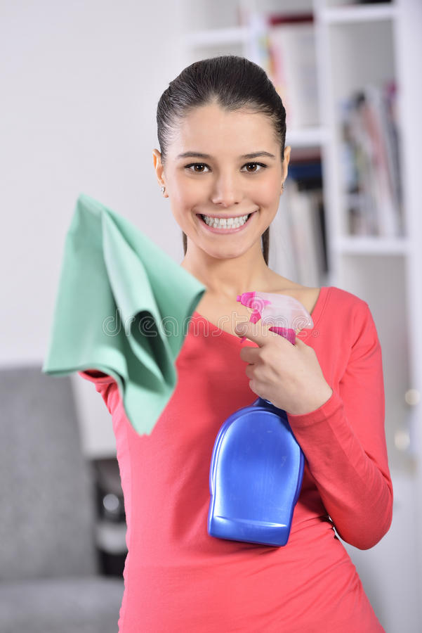 Cleaning the house. Women cleaning house finish. attractive girl looking at camera ok sign stock images