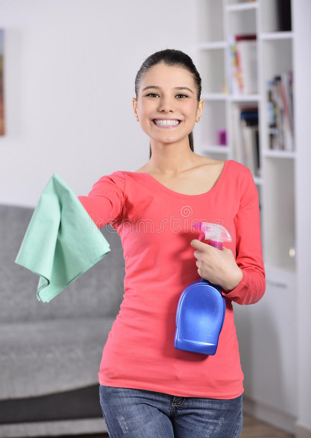 Cleaning the house. Women cleaning house finish. attractive girl looking at camera ok sign stock image