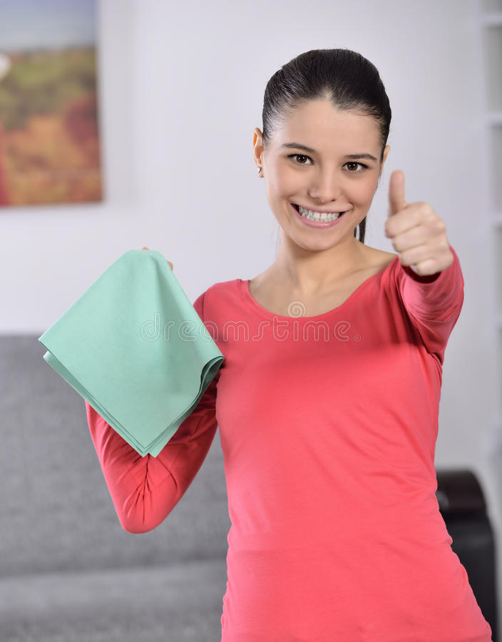 Cleaning the house. Women cleaning house finish. attractive girl looking at camera ok sign royalty free stock photo