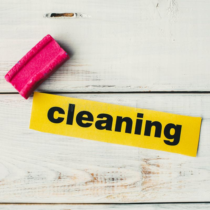 Cleaning inscription and a clothes brush royalty free stock image