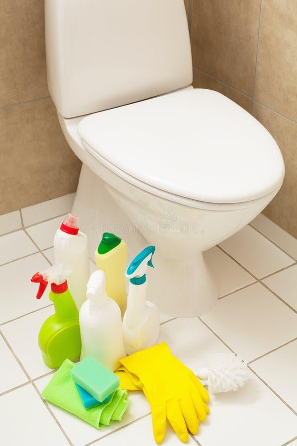 Cleaning items gloves brush white toilet bowl bathroom stock photos