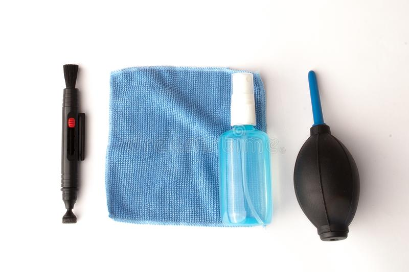 Cleaning kit for camera lenses on a white background, photographer accessories, professional lenses cleaning service stock images