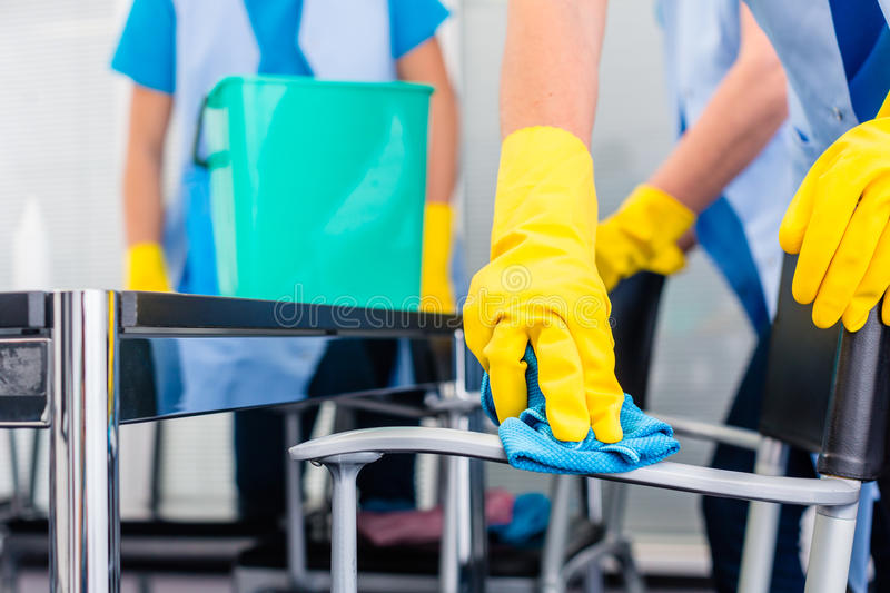 Cleaning ladies working as team in office royalty free stock photo