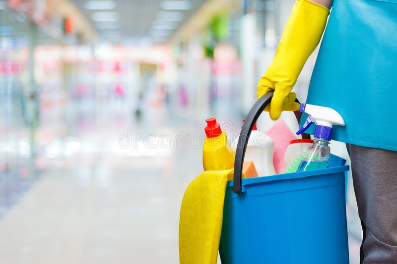 Cleaning lady with a bucket and cleaning products. royalty free stock photo
