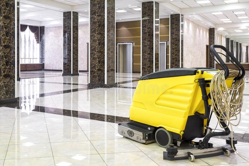 Cleaning machine in the empty office lobby royalty free stock image