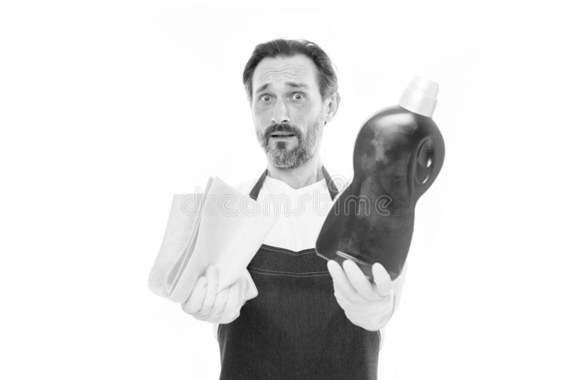 Cleaning and maintenance Senior man holding bottle of domestic cleaning fluid and wiper. Mature man doing household stock photography