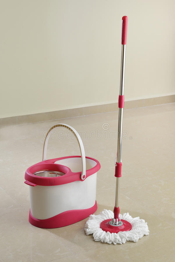 Cleaning mop and Bucket With Drying Spinner on Floor. High resolution image of cleaning mop with spinning technology for drying microfiber head on flooring stock images