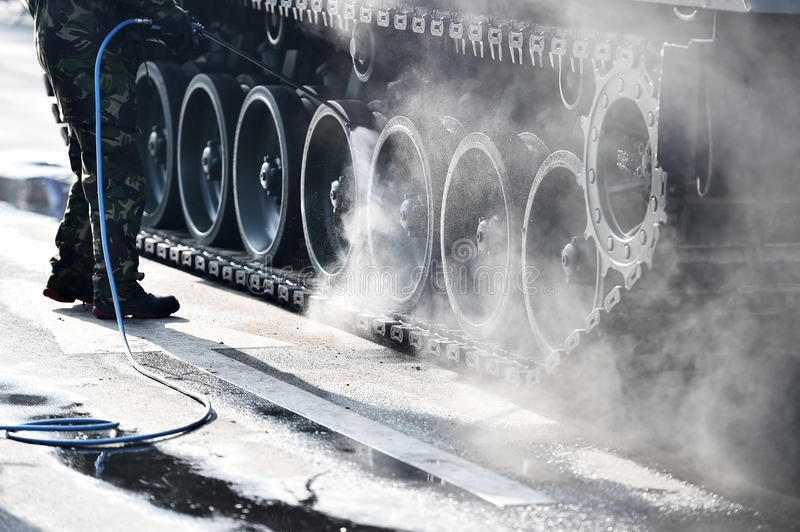 Cleaning off tank tracks detail stock photo
