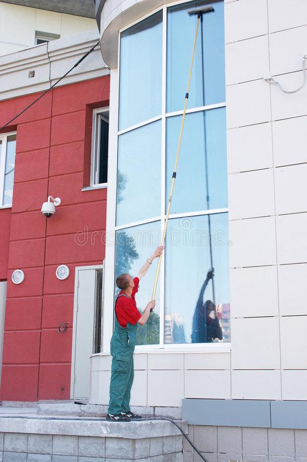 Cleaning Office Window Royalty Free Stock Photos