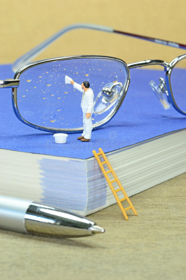 Cleaning A Pair Of Spectacles Royalty Free Stock Photography