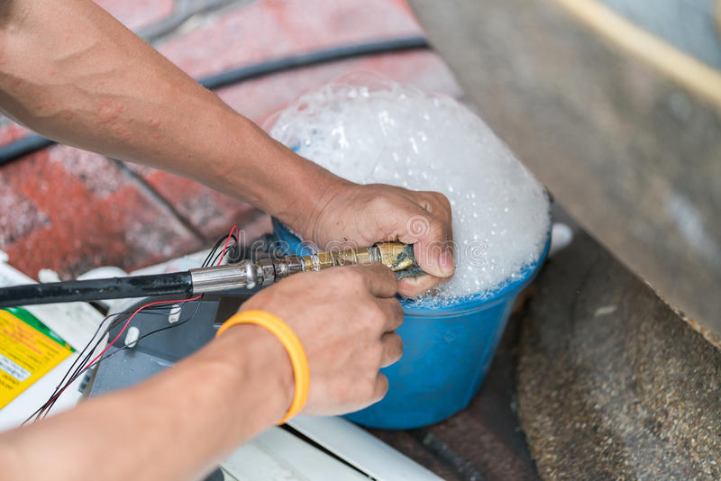 Cleaning part of air conditioner. Machanic stock photography
