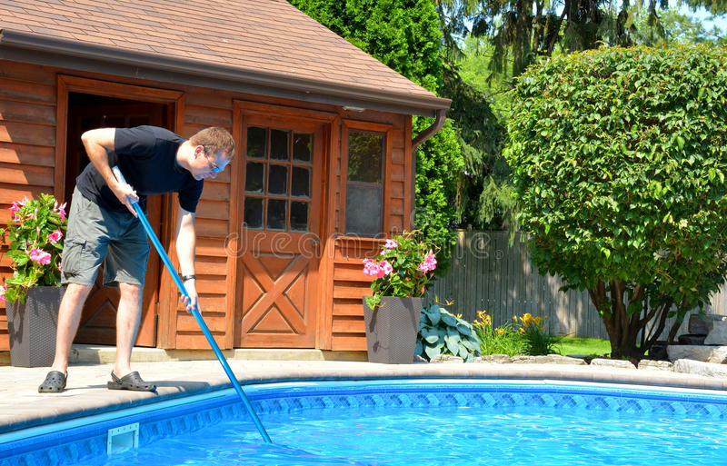 Cleaning the pool royalty free stock image