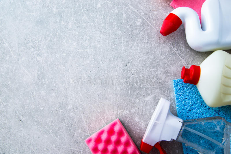 Cleaning products on stone background with copyspace. top view stock photo