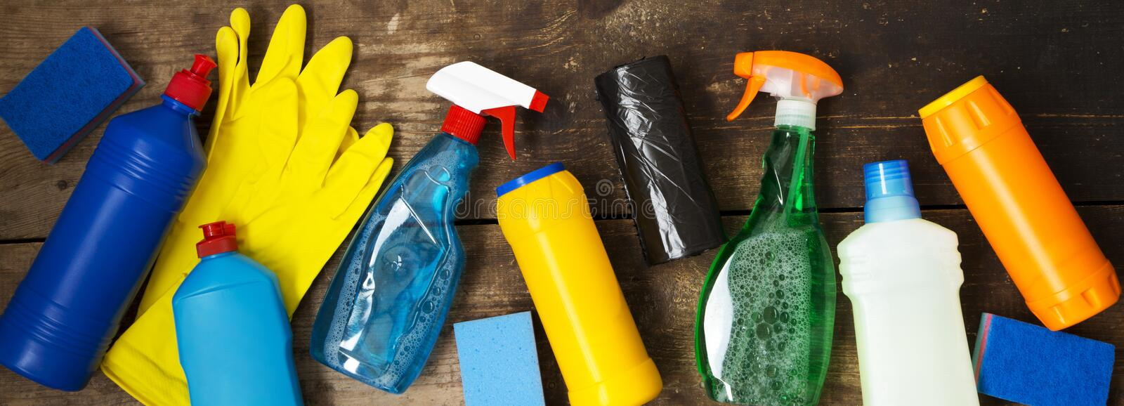 Cleaning products on wooden surface. House cleaning concept. Overhead view. From above. Flat lay stock photo