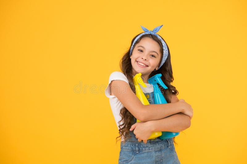 Cleaning products that work. Happy little girl enjoy doing house work. Cute small child ready for cleaning work. Clean royalty free stock photos