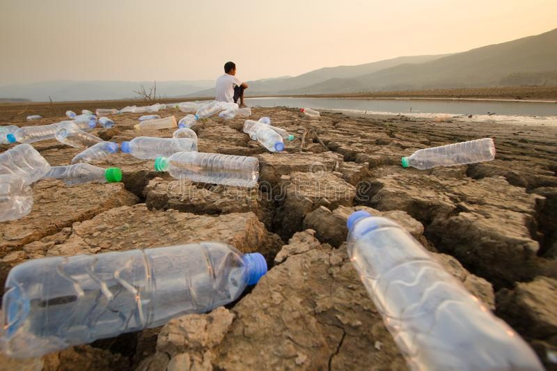Cleaning river and Save world from plastic concept. stock image