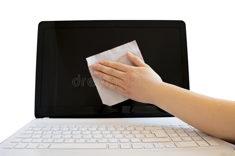 Cleaning the screen of a computer stock photo