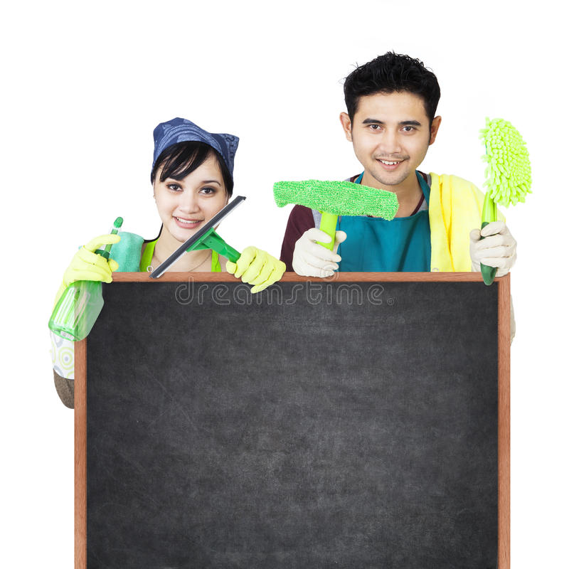 Cleaning service couple holding blackboard stock photo