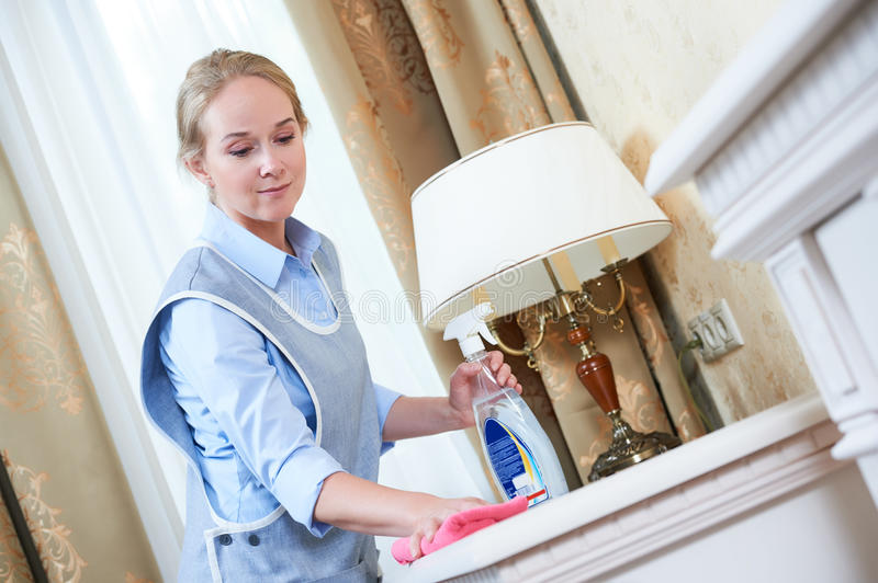Cleaning service. hotel staff removing dust stock photography