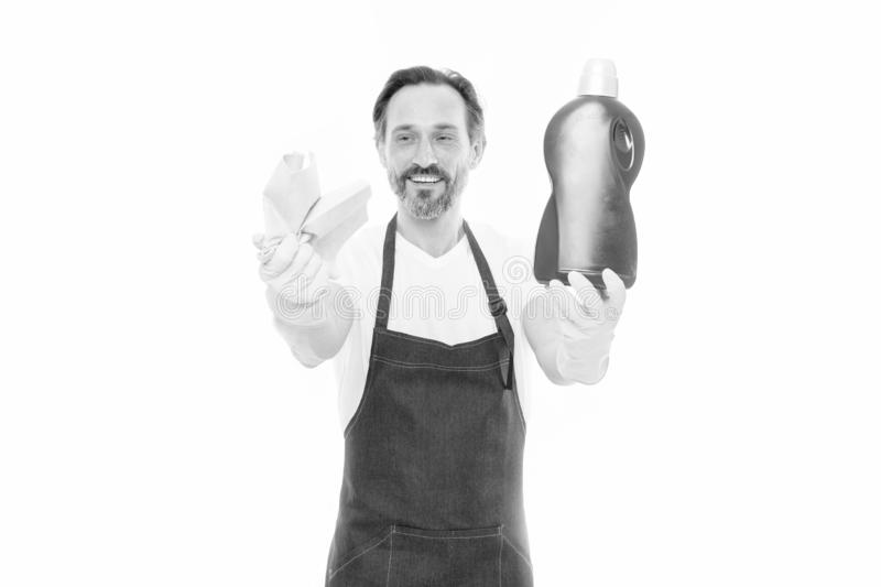 Cleaning service and household duty. Man in rubber gloves hold bottle liquid soap chemical cleaning agent. Bearded guy stock image