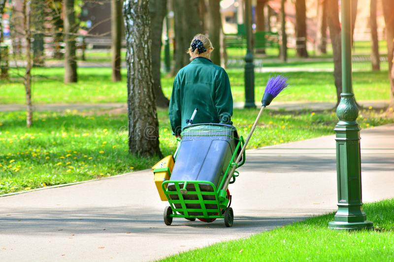 Cleaning service for park areas. Gardener with janitor equipment royalty free stock photos
