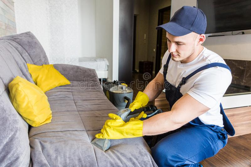 Cleaning service with professional equipment during work. professional kitchenette cleaning, sofa dry cleaning, window stock images