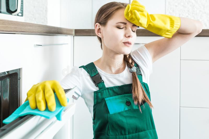 Cleaning service with professional equipment during work. professional kitchenette cleaning, sofa dry cleaning, window royalty free stock photography