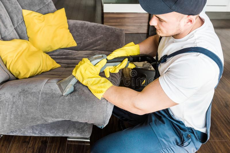 Cleaning service with professional equipment during work. professional kitchenette cleaning, sofa dry cleaning, window royalty free stock image