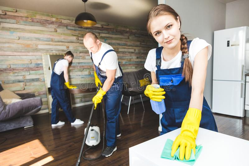 Cleaning service with professional equipment during work. professional kitchenette cleaning, sofa dry cleaning, window stock photo