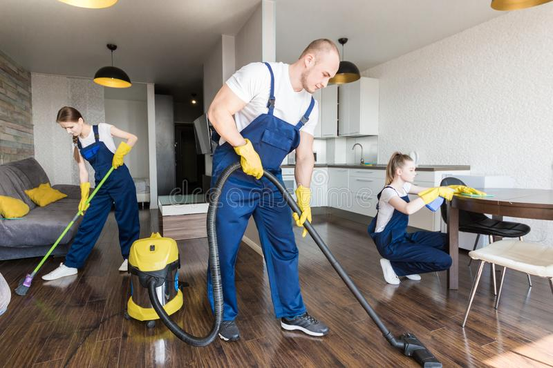 Cleaning service with professional equipment during work. professional kitchenette cleaning, sofa dry cleaning, window stock photography