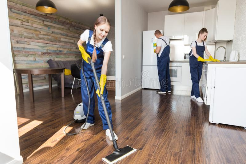 Cleaning service with professional equipment during work. professional kitchenette cleaning, sofa dry cleaning, window stock photos