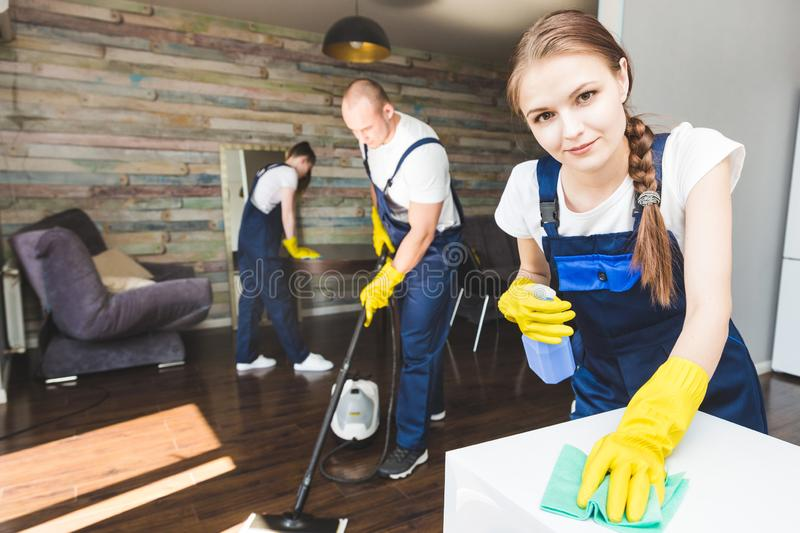 Cleaning service with professional equipment during work. professional kitchenette cleaning, sofa dry cleaning, window royalty free stock images