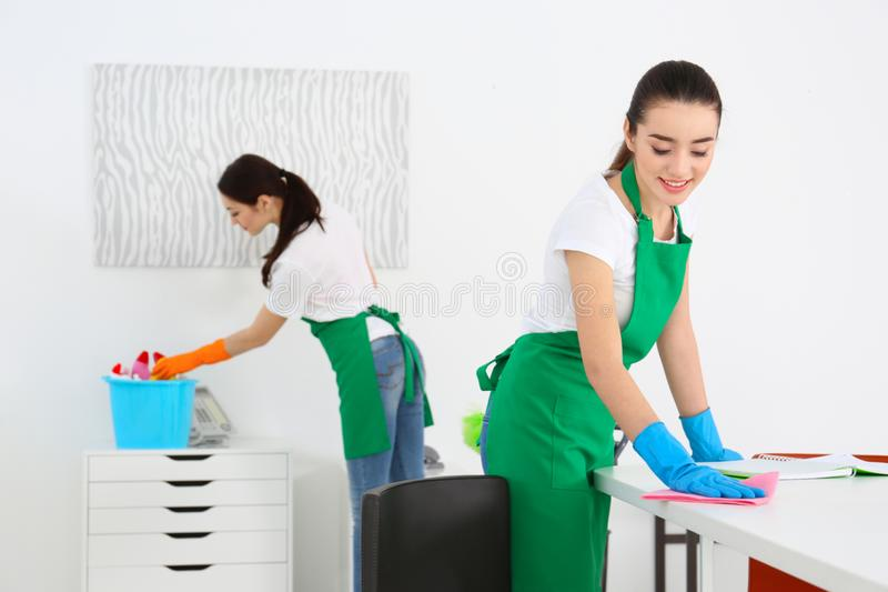 Cleaning service team at work stock images